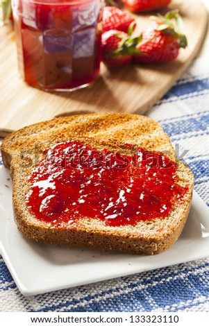 Homemade Organic Red Strawberry Jelly on a piece of toast