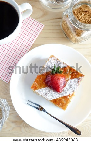 Homemade organic strawberry pie on white plate