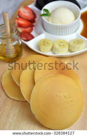 Homemade pancake pile with set of dipping