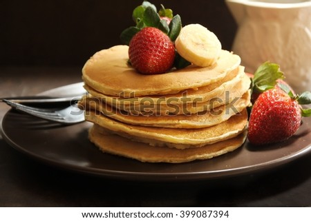 Homemade pancakes on dark moody background, selective focus
