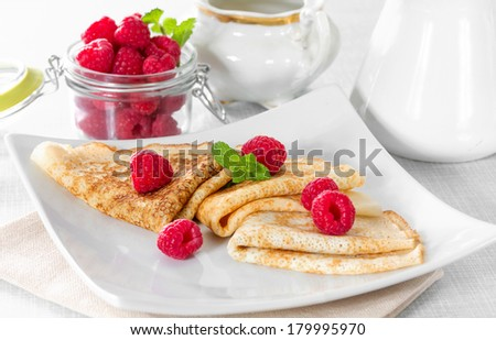 Homemade pancakes with raspberries and mint
