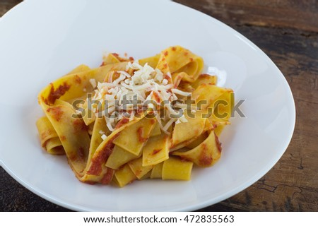 homemade pappardelle with tomato and basil with parmesan