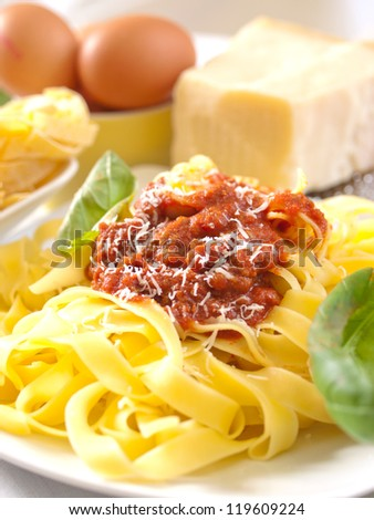homemade pasta noodles with bolognese sauce