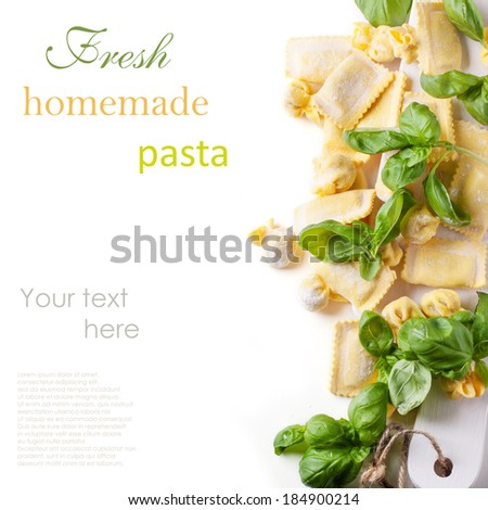 Homemade pasta ravioli and perle with fresh basil over white with sample text - stock photo