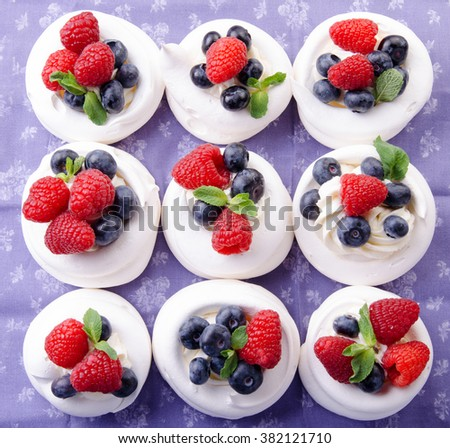 Homemade pavlova meringue cake with fresh berries and whipped cream. Morning. Dessert. Top view. - stock photo