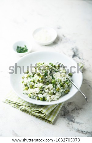 Homemade pea risotto with fresh herbs