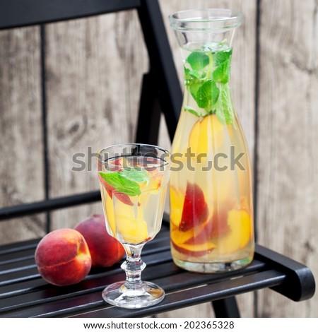Homemade peach mint lemonade, selective focus - stock photo