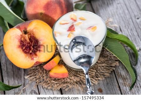 Homemade Peach Yogurt with fresh fruits on wooden background - stock photo