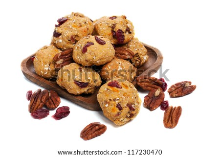Homemade pecan and cranberry cookies on white background - stock photo