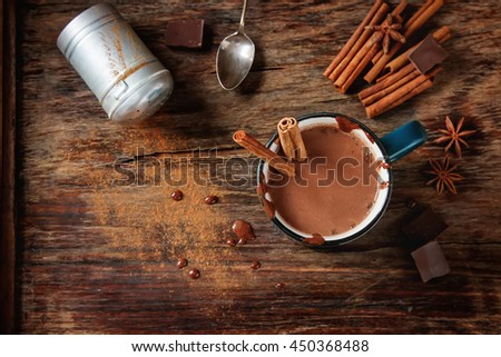 Homemade Peppermint hot chocolate with cinnamon sticks on a dark background. The area of the image with selective focus.  - stock photo