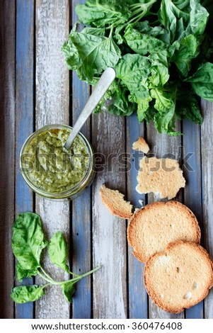Homemade pesto on a rustic wooden tray
