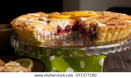 Homemade pie covered with strawberries and rhubarb and meringue. Home baking in vintage style. Fruit pie. - stock photo