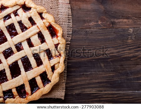 Homemade pie with jam on the wooden table. Top view.  - stock photo