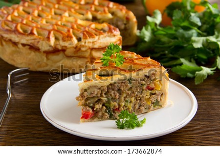 Homemade pie with meat. - stock photo