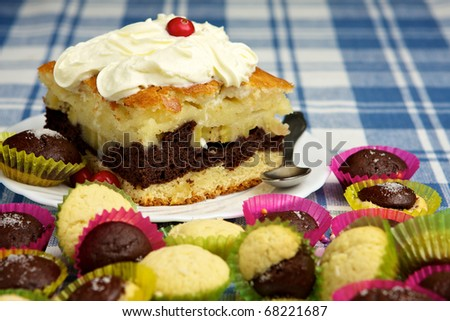 Homemade pie with whipped cream and muffins
