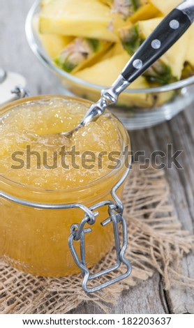 Homemade Pineapple Jam in a small glass with fresh fruit pieces