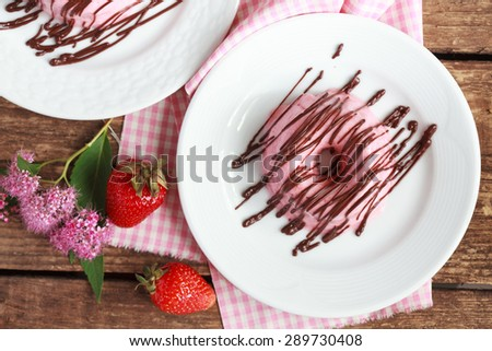 Homemade pink Souffle made from cream, strawberry puree and gelatin, decorated chocolate. Selective focus and top view - stock photo