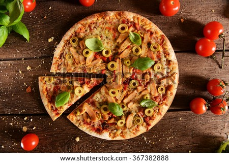 Homemade pizza with green olives, chicken and pepper, - stock photo