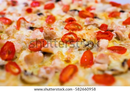 Homemade pizza with tomatoes, cheese and champignons