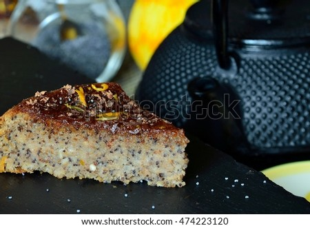 Homemade poppy seed cheese cake with oranges. selective focus