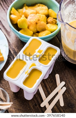 Homemade popsicle, summer refreshin treat lolly,from exotic fruits - stock photo