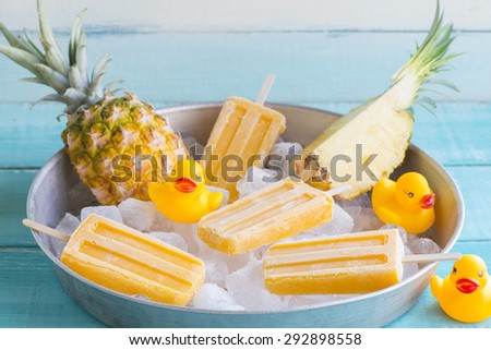 Homemade popsicles made of pineapple - stock photo