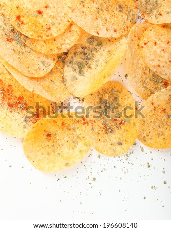Homemade potato chips isolated on white - stock photo