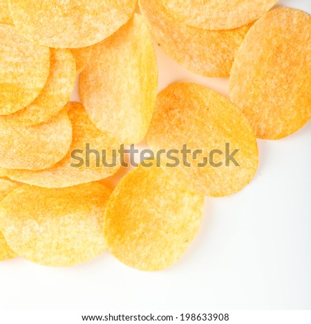 Homemade potato chips isolated on white