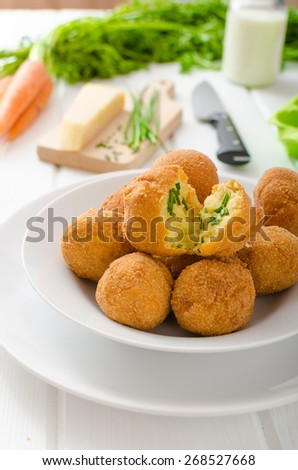 Homemade potato croquettes with parmesan and chives, nice and simple, but delicious light food - stock photo
