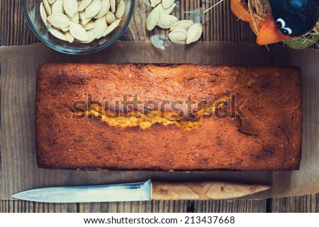 Homemade pound cake baked in a loaf pan on a wooden board  viewed from above - stock photo