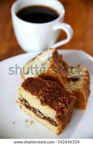 Homemade Pound Cake on table top with white plate and white coffee mug