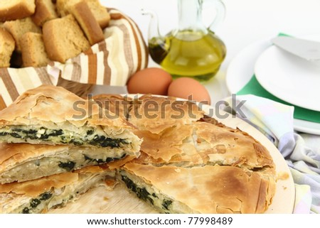 Homemade puff spinach pie with filo pastry - stock photo