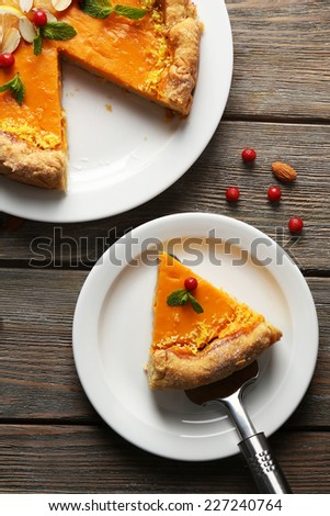 Homemade pumpkin pie on table