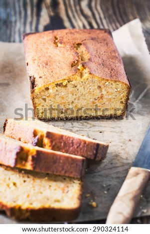 Homemade pumpkin pound cake baked in a loaf pan on a wooden board - stock photo