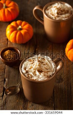 Homemade Pumpkin Spice Latte with Cream and Cinnamon - stock photo