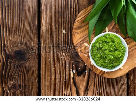 Homemade Ramson Pesto on wooden background (close-up shot) - stock photo