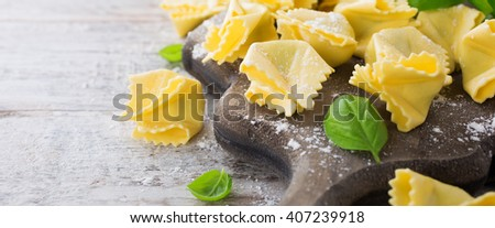 Homemade raw Italian saccottini with green pesto - stock photo