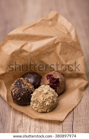 Homemade raw vegan sweet balls on wooden table