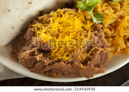Homemade Refried Beans with Cheese and Rice - stock photo