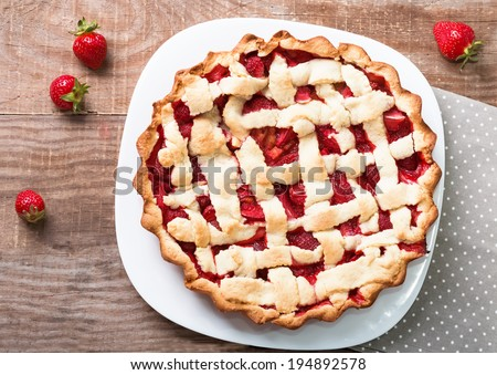 Homemade rhubarb and strawberry cake on the table, up view - stock photo