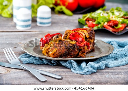 Homemade Roasted Turkey with all the Sides. Turkey drumstick, baked with garlic, pepper, tomato,onion and herbs with salad on the wooden table. Preparing the Sunday family dinner or summer grill. - stock photo
