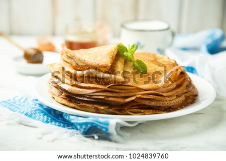 Homemade Russian pancakes with organic honey
