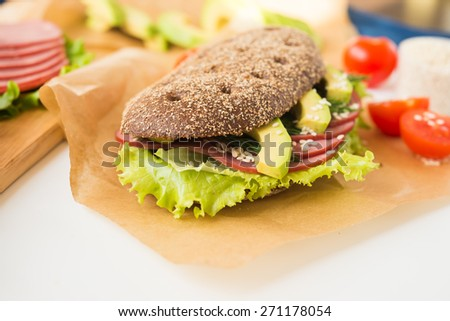 Homemade Sandwich with Beef Ham, Lettuce and Avocado - stock photo