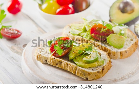 Homemade sandwiches with sliced avocado and tomato. Selective focus