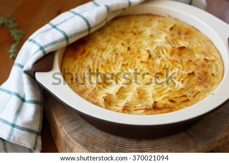 homemade Shepherd's Pie in the casserole dish. - stock photo