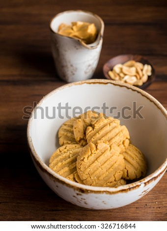 Homemade shortbread cookies with oats and peanut butter in a bowl on a wooden rustic dark table, selective focus - stock photo
