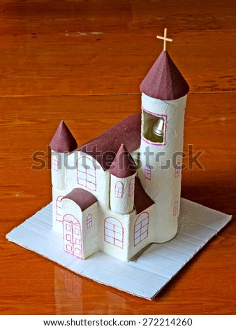 Homemade simple paper model of the church        - stock photo