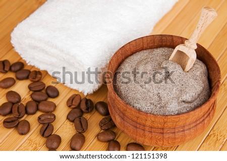 Homemade skin exfoliant (skin scrub) of ground coffee and sour cream - stock photo