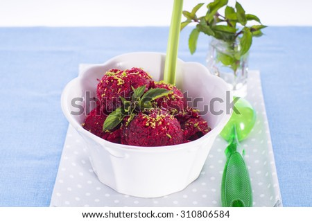 Homemade sorbet with fresh berries and mint in old white bowl - stock photo