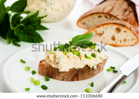 Homemade spicy cheese with bread on a white wood table - stock photo